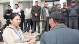 Radio Azattyk correspondent Zamira Kojobaeva (left, with microphone) interviewing protesters as the second Kyrgyz Revolution begins on April 6, 2010 with unrest in the western Kyrgyzstan city of Talas.