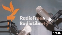 Microphones and RFERL logo on background