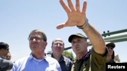 U.S. Secretary of Defense Ash Carter (left), Israeli Defense Minister Moshe Ya'alon (center), and Israeli Brigadier General Moni Katz view the Hula Valley from the Hussein Lookout near Kiryat Shmona in northern Israel on July 20.