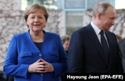 Ангела Меркель и Владимир Путин на международной конференции по Ливии в Берлине. Январь 2020 года