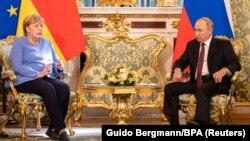 RUSSIA -- Russian President Vladimir Putin receives German Chancellor Angela Merkel at the Kremlin in Moscow, August 20, 2021