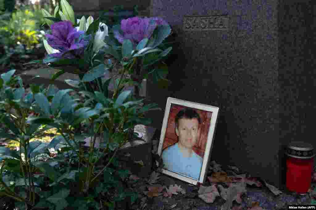 A photograph sits beside Aleksandr Litvinenko's gravestone in Highgate Cemetery in North London.