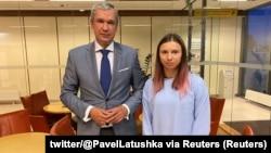 Belarusian opposition politician Paval Latushka greets sprinter Krystsina Tsimanouskaya upon her arrival in Warsaw on August 4.