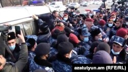 Armenia - Riot police detain opposition activists outside the parliament building in Yerevan, February 3, 2021.