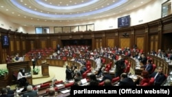 Lawmakers in session in the parliament in Yerevan on March 24