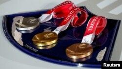 Токио Олимпиадасынын медалдары.