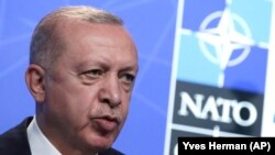 Turkish President Recep Tayyip Erdogan speaks during a media conference at a NATO summit in Brussels on June 14.