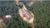 Здание, которое, как утверждают расследователи ФБК, является СПА-комплексом и расположено на территории «дачи Путина» на Валдае. Скриншот видеозаписи.