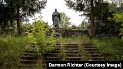 Thirty-five years after Soviet Ukraine's infamous nuclear disaster, a photographer has uncovered the haunting and often carefully maintained World War II monuments that endure in the forests of the Chernobyl exclusion zone.