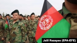 Afghan National Army soldiers attend a graduation ceremony in Herat.