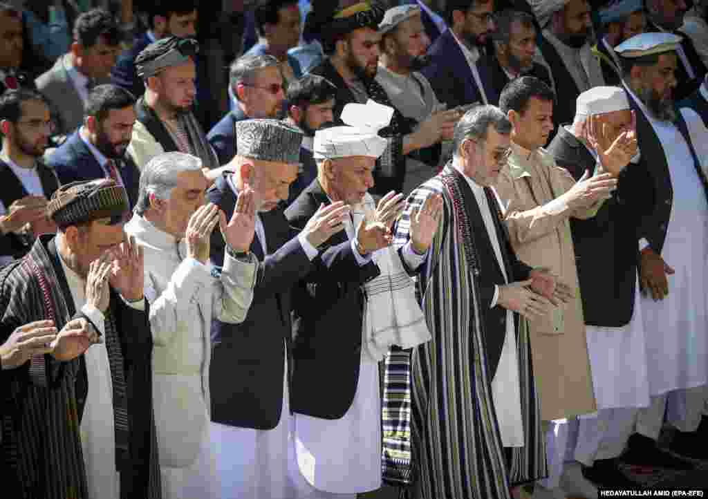 Afghan President Ashraf Ghani attends, with other officials, prayers at the presidential palace in Kabul, Afghanistan.
