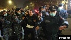 Armenia -- Riot police detain an opposition protester in Yerevan, December 1, 2020.