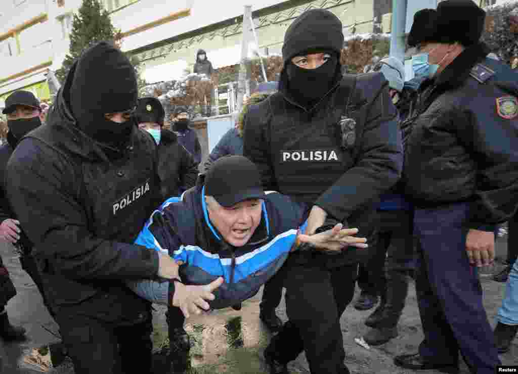 Kazakh police detain a man during a protest denouncing what opposition supporters called political repression in Almaty on February 28. (Reuters/Pavel Mikheyev)