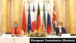 AUSTRIA -- Iran's top nuclear negotiator Abbas Araqchi and Secretary General of the European External Action Service (EEAS) Helga Schmid attend a meeting of the JCPOA Joint Commission in Vienna, September 1, 2020