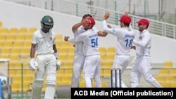 Afghan players celebrate a wicket of the Zimbabwe cricket team in March.