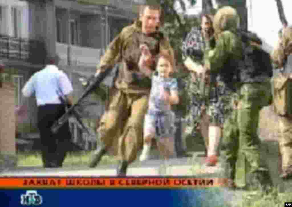 A television grab of the end of the seige in Beslan, September 3, 2004 (epa) - Three local police officers were found guilty of negligence in the run-up to the siege, but were granted amnesty earlier this year.
