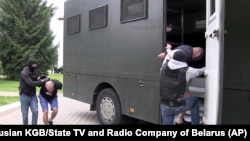 Belarusian KGB officers detain a Russian man in a sanitarium outside of Minsk on July 29.