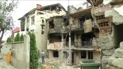 Macedonians Survey Gunbattle Damage