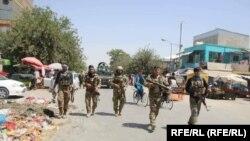 Afghan troops on patrol in the city of Kunduz on June 25.