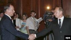 ნიკოლაი პატრუშევი, რუსეთის უსაფრთხოების სამსახურის მდივანი და ვლადიმირ პუტინი, რუსეთის პრემიერ-მინისტრი