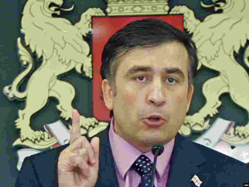 "Georgian President Mikheil Saakashvili speaks at a news conference in Tbilisi. He said that ""there is a large-scale military aggression going on against Georgia"" and announced a ""total mobilization"" of Georgian military forces."