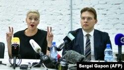 Belarusian pro-democracy activists Maryya Kalesnikava (left) and Maksim Znak (file photo)