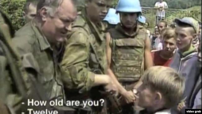 A screen grab of Bosnian Serb General Ratko Mladic meeting a Bosnian Muslim boy shortly before