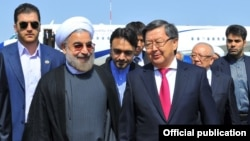 Iranian President Hassan Rohani (front left) and Kyrgyz Prime Minister Jantoro Satybaldiev (front right) ahead of a Bishkek summit