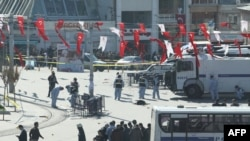 Police investigate the area where a suicide bomber blew himself up in the center of Istanbul.