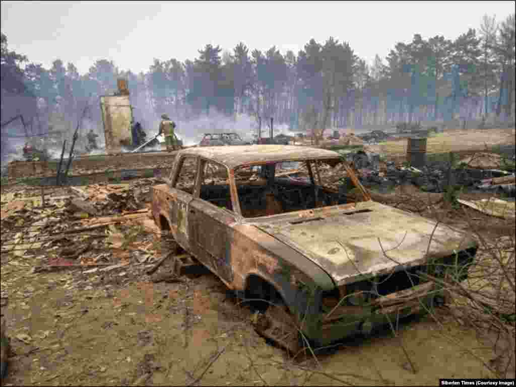 A burned-out car after the current blazes tore through a village in Buryatia. As of May 11, there were 116 fires burning across Siberia and Russia's far east. No fatalities have yet been reported.