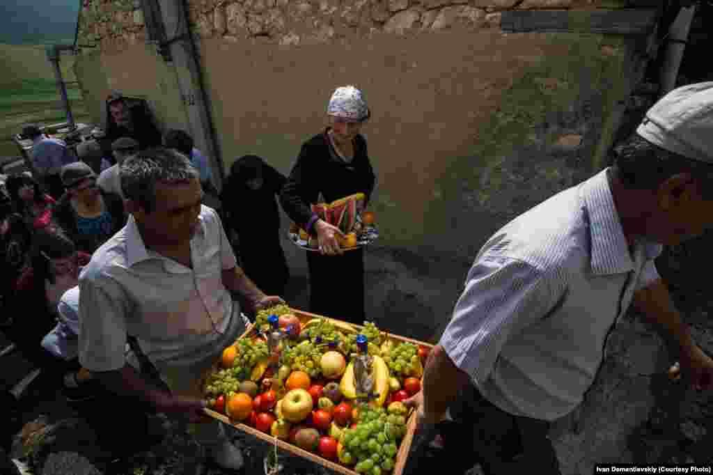 Villagers transport food to an open-air hilltop wedding feast.