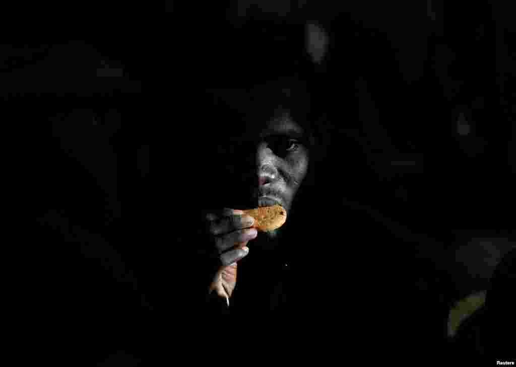 A migrant eats a biscuit on the Migrant Offshore Aid Station (MOAS) ship Topaz Responder after being rescued around 20 nautical miles off the coast of Libya. (Reuters/Darrin Zammit Lupi )