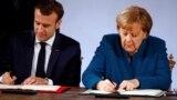 Президент Франції Емманюель Макрон і канцлер Німеччини Анґела Меркель під час підписання Аахенської угоди. Аахен, 22 січня 2018 року