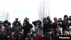 Armenia -- TV cameramen and photographers cover an event in Yerevan.