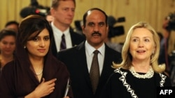 U.S. Secretary of State Hillary Clinton (far right) with Pakistan's Foreign Minister Hina Rabbani Khar (far left) in Islamabad.