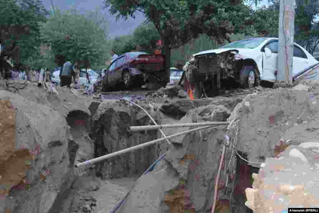 Flooding tore up roads and upended vehicles in Charikar.