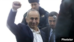 Former President Robert Kocharian greets supporters during his trial in Yerevan on February 25.