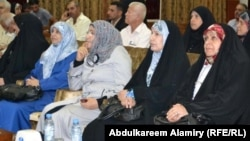 Iraqi women activists and legislators gather for a conference on women's empowerment in Basra in September. The new law seeks to compensate for some of the obstacles women face in getting work in Iraq today.