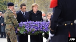 French President Nicolas Sarkozy and German Chancellor Angela Merkel take part in the Armistice Day ceremony marking 91 years since the end of World War I on November 11.