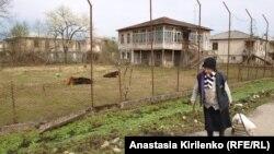 A woman walks in Gali, in Abkhazia.
