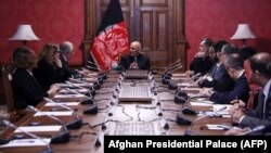 Afghan President Ashraf Ghani (center) talks with U.S. special representative for Afghan peace and reconciliation, Zalmay Khalilzad (upper left), during a cabinet meeting at the Presidential Palace in Kabul on January 27.