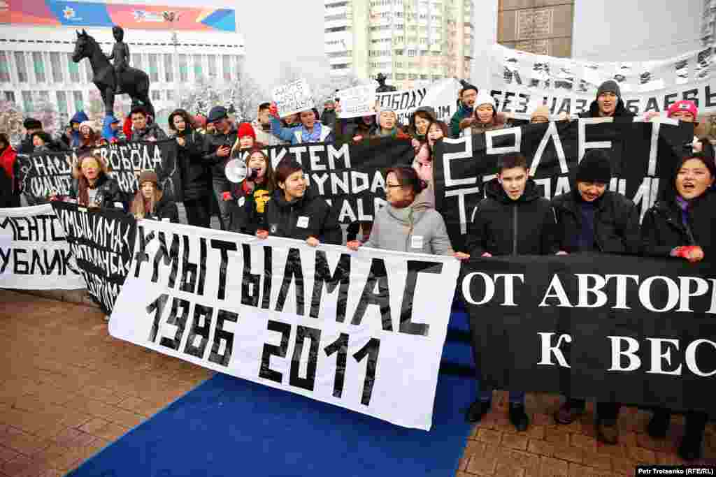 Activists of the youth movement Oyan, Qazaqstan (Wake Up, Kazakhstan) are seen at the Independence Monument in Almaty on December 16.