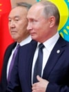 Kazakhstan - Russian President Vladimir Putin, right, and his Kazakhstan's counterpart Nursultan Nazarbayev, pose for a photo at a meeting of heads of states-members of the Collective Security Treaty Organization in Astana, Kazakhstan, Thursday, Nov. 8, 2