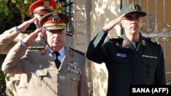 SYRIA -- Chief of staff of the joint Syrian armed forces Lt. Gen. Ali Ayoub (L) salutes next to his Iranian counterpart Major General Mohammad Hossein Bagheri during a welcome ceremony for the latter in Damascus, October 18, 2017