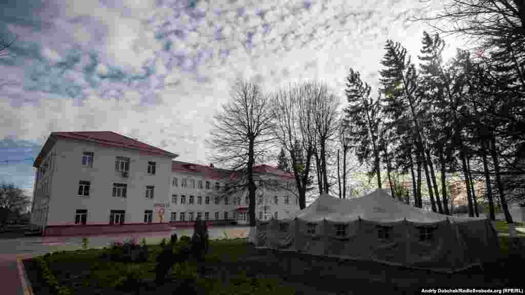 A military-style tent outside Kalynivka's central hospital. There have been 37 coronavirus cases reported among medical staff since a 79-year old local woman was admitted in early April with the infection before doctors and nurses began wearing protective equipment. The woman has since died.