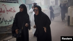 Protesters chant slogans after Bahraini police used a stun grenade during an antigovernment rally in Manama on April 19.