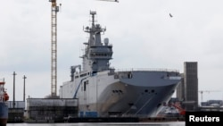 "The Mistral-class helicopter carrier ""Vladivostok"" is seen at the STX Les Chantiers de l'Atlantique shipyard site in Saint-Nazaire, western France, in April."