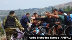 PHOTO GALLERY: Thousands Of Migrants Force Way Into Macedonia