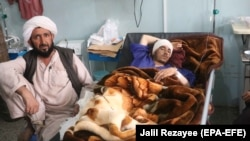 Afghan civilian injured in bomb blast in May 2021 receives medical treatment at a hospital in Herat.
