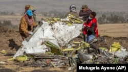 Rescuers work at the scene of the Ethiopian Airlines crash on March 11.